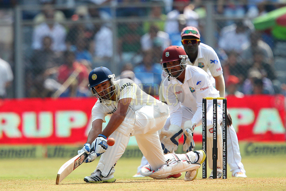 Rohit Sharma of India  during day two of the second Star Sports test match between India and The West Indies held at The Wankhede Stadium in Mumbai, India on the 15th November 2013<br /> <br /> This test match is the 200th test match for Sachin Tendulkar and his last for India.  After a career spanning more than 24yrs Sachin is retiring from cricket and this test match is his last appearance on the field of play.<br /> <br /> <br /> Photo by: Ron Gaunt - BCCI - SPORTZPICS<br /> <br /> Use of this image is subject to the terms and conditions as outlined by the BCCI. These terms can be found by following this link:<br /> <br /> http://sportzpics.photoshelter.com/gallery/BCCI-Image-Terms/G0000ahUVIIEBQ84/C0000whs75.ajndY