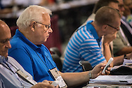 Delegate Dennis Smith of Orland Park, Ill., works with the electronic voting system during the 66th Regular Convention of The Lutheran Church–Missouri Synod on Sunday, July 9, 2016, at the Wisconsin Center in Milwaukee. LCMS/Frank Kohn