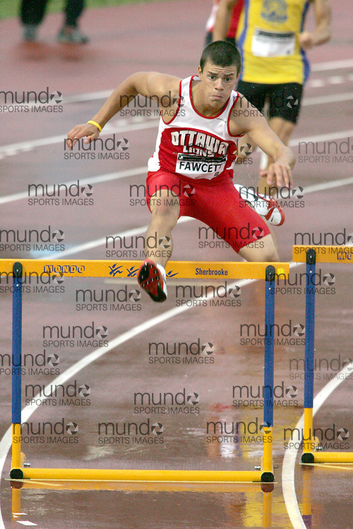(Sherbrooke, Canada---22 July 2006) Tyler Fawcett competing in the 400m hurdles qualifying rounds at  the 2006 Canadian Junior Track and Field Championships and national multi-events championships 21-23 July 2006 held in Sherbrooke Quebec. Copyright 2006 Sean Burges / Mundo Sport Images, www.mundosportimages.com