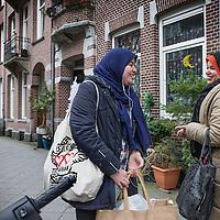 Nederland, Amsterdam, 2 februari 2016.<br /> Mona Ghadir uit de Transvaalbuurt doet boodschappen in de Pretoriastraat om falaffel te maken.<br /> In de Pretoriastraat komt Mona haar dochter tegen.<br /> <br /> Reportage of egyptian Mona Ghadir living in Amsterdam. Today she shops for ingredients and prepares typical egyptian dishes. <br /> <br /> Foto: Jean-Pierre Jans