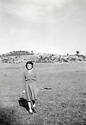 young girl walking in an open field 1950 rural France