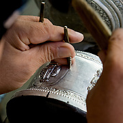 Closeup detail of artisan carving silver (Luang Prabang (Louangphrabang), Laos - Nov. 2008) (Image ID: 081124-1002531a)