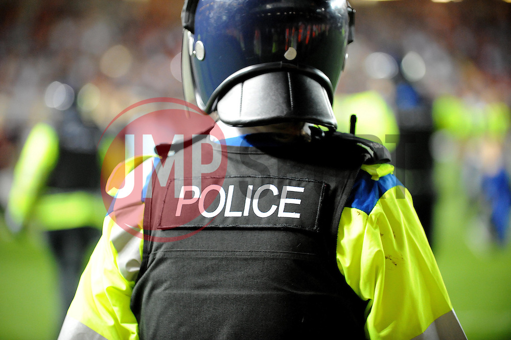 The police move in to remove the crowd from the pitch  - Photo mandatory by-line: Dougie Allward/JMP - Tel: Mobile: 07966 386802 04/09/2013 - SPORT - FOOTBALL -  Ashton Gate - Bristol - Bristol City V Bristol Rovers - Johnstone Paint Trophy - First Round - Bristol Derby