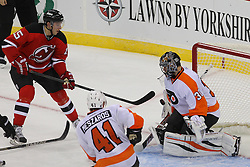 Jan 22, 2013; Newark, NJ, USA; Philadelphia Flyers goalie Ilya Bryzgalov (30) makes a save on New Jersey Devils center Stefan Matteau (15) during the second period at the Prudential Center.