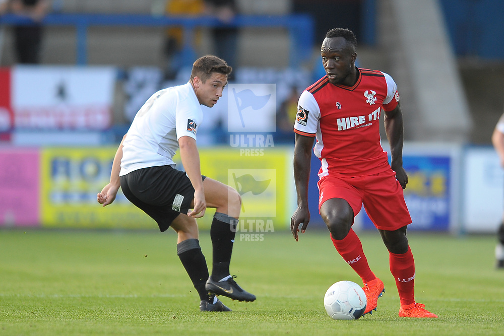 TELFORD COPYRIGHT MIKE SHERIDAN Adam Walker chases down Cliff Moyo during the National League North fixture between AFC Telford United and Kidderminster Harriers on Tuesday, August 6, 2019.<br /> <br /> Picture credit: Mike Sheridan<br /> <br /> MS201920-006