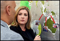 October 4, 2018 - London, London, United Kingdom - Penny Mordaunt visits DEC HQ. Secretary of State for International Development Penny Mordaunt talks to staff representing charities as she visits the Disaster Emergency Committee HQ in central London, in response to the Indonesia tsunami. (Credit Image: © Andrew Parsons/i-Images via ZUMA Press)