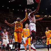 31 January 2017:  The San Diego State Aztecs men's basketball team hosts Wyoming Tuesday night at Viejas Arena. San Diego State guard Montaque Gill-Cesaer (23) attempts a reverse layup while being defended by Wyoming guard Louis Adams (24) in the second half. The Aztecs beat the Cowboys 77-68 at half time. www.sdsuaztecphotos.com