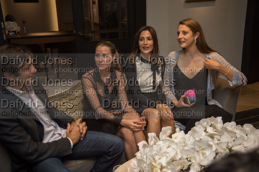 EDUARDO NOVILLO ASTRADA; COSIMA VESEY; ; ASTRID MUNOZ; ANNA DE PAHLEN  preview of 'UNBRIDLED SYNCHRONY', an exhibition of works by photographer Astrid Muñoz. Jaeger-LeCoultre Boutique<br /> 13 Old Bond Street. London. 13 July 2015