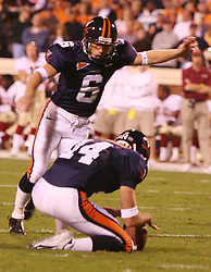 UVA place kicker Connor Hughes (6) on a kick against FSU.  The Virginia Cavaliers defeated the #4 ranked Florida State University Seminoles 26-21 on October 15, 2005 at Scott Stadium in Charlottesville, VA.