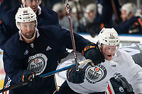 KELOWNA, BC - SEPTEMBER 22:  Sam Gagner #89 checks Colby Cave #12 of the Edmonton Oilers during practice at Prospera Place on September 22, 2019 in Kelowna, Canada. (Photo by Marissa Baecker/Shoot the Breeze)