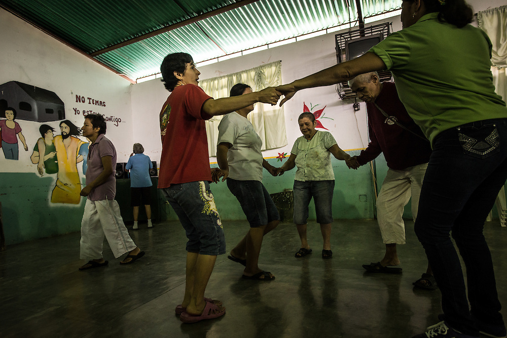 "BARQUISIMETO, VENEZUELA - AUGUST 25, 2016: Therapists put on salsa music for patients to dance every Friday in the hospital rec center. Before the crisis, when patients were receiving all the medicines they needed - and the hospital had healthy government funding, they had a much more robust therapy program at the rec center.  They held weekly sewing, cooking, and sculpture classes.  They had a farming program where patients grew fresh vegetables, and a sports program.  Now, there is no funding for any sort of therapy except picking at the blocks of recycled material, and unmedicated patients are too unstable to do those types of activities anymore.  ""When patients have their medicines, they can do really complex crafts. Now they just do simple tasks,"" said art therapist Mirthis Fernández.  PHOTO: Meridith Kohut for The New York Times"