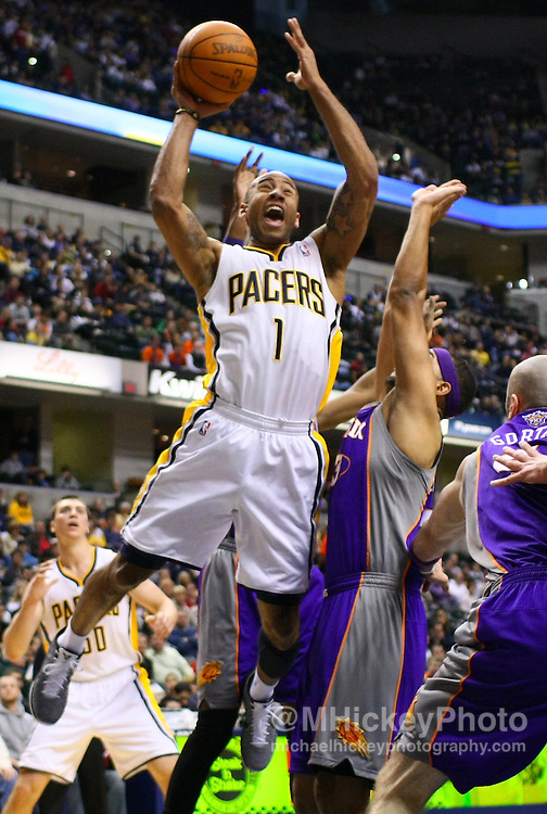 Feb. 27, 2011; Indianapolis, IN, USA; Indiana Pacers guard Dahntay Jones (1) puts the ball up against the Phoenix Suns at Conseco Fieldhouse. Mandatory credit: Michael Hickey-US PRESSWIRE