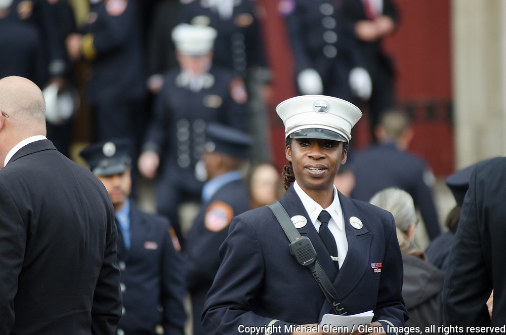 25 Mar 2017 Bronx, New York United States of America // FDNY Lt Tracy Lewis of the Ceremonial unit helps to prepare for the Funeral Service for EMT Yadira Arroyo at FDNYEMS Station 26 at the Saint Nicholas of Tolentine R.C.  Bronx. EMT Arroyo, who lived in the Bronx, is survived by her five sons, Jose Montes, 23; Edgar Montes, 22; Kenneth Robles, 19; Justin Robles, 16; and Isaiah Negron, 7; her parents, mother Laida Acevedo-Rosado and father Luis Arroyo, Sr.; her siblings Joell Arroyo and Luis Arroyo, Jr.; and numerous other relatives, including her stepfather Efrain Rosado and nine aunts and uncles.  Michael Glenn / Glenn Images