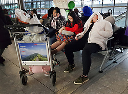 © Licensed to London News Pictures. 11/12/2017. London, UK. Passengers sleep in seats at Heathrow's Terminal 5 after yesterday's snow continues to affect transport. British Airways had already cancelled 30 flights before 10am today. Photo credit: Peter Macdiarmid/LNP