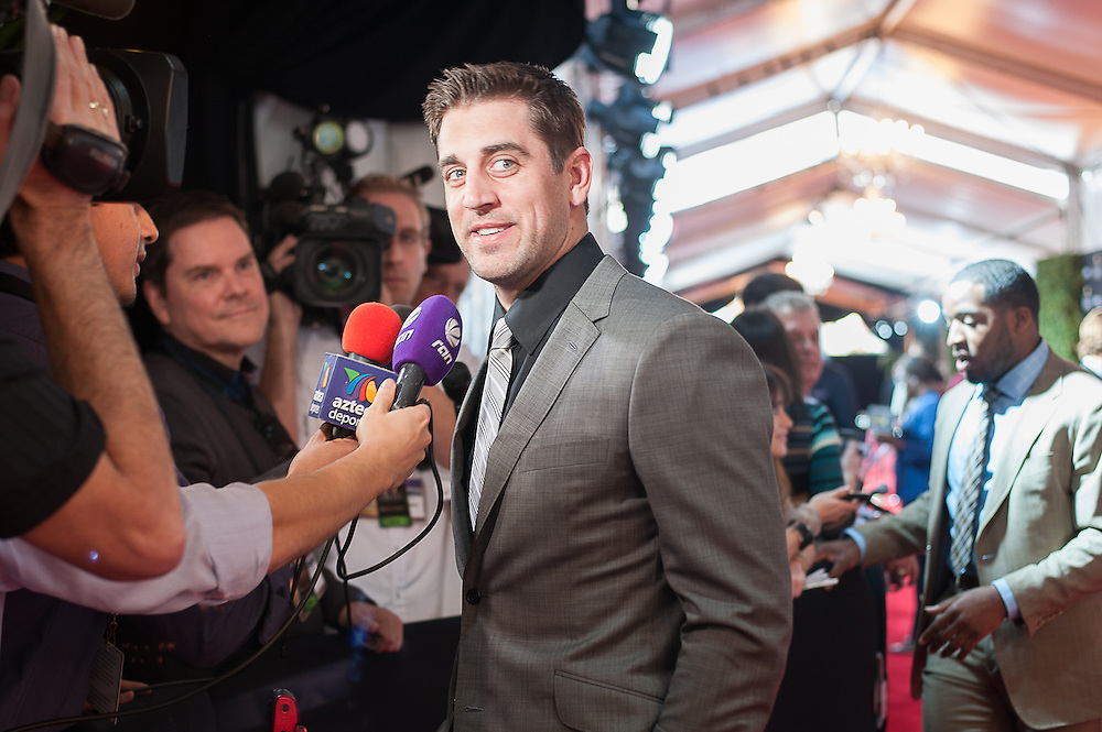 Aaron Rogers posing by NFL networks Alex Flanagan at the Mahalia Jackson Theatre NFL Honors in New Orleans, Louisiana on Feb.2 2013.