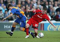 Photo: Rich Eaton.<br /> <br /> Shrewsbury Town v Milton Keynes Dons. Coca Cola League 2. Play off Semi Final, 1st Leg. 14/05/2007. Shrewsburys Luke Jones left is beaten to the ball by John Hayes of MK Dons