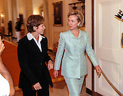 First lady Hillary Rodham Clinton enters with Katie Couric at an event on colon cancer on the day the Starr Report is delivered to Congress September 10, 1998 in Washington, DC. Mrs. Clinton announced a new research grant to fight colon cancer and unveiled a new public service announcement to promote prevention.