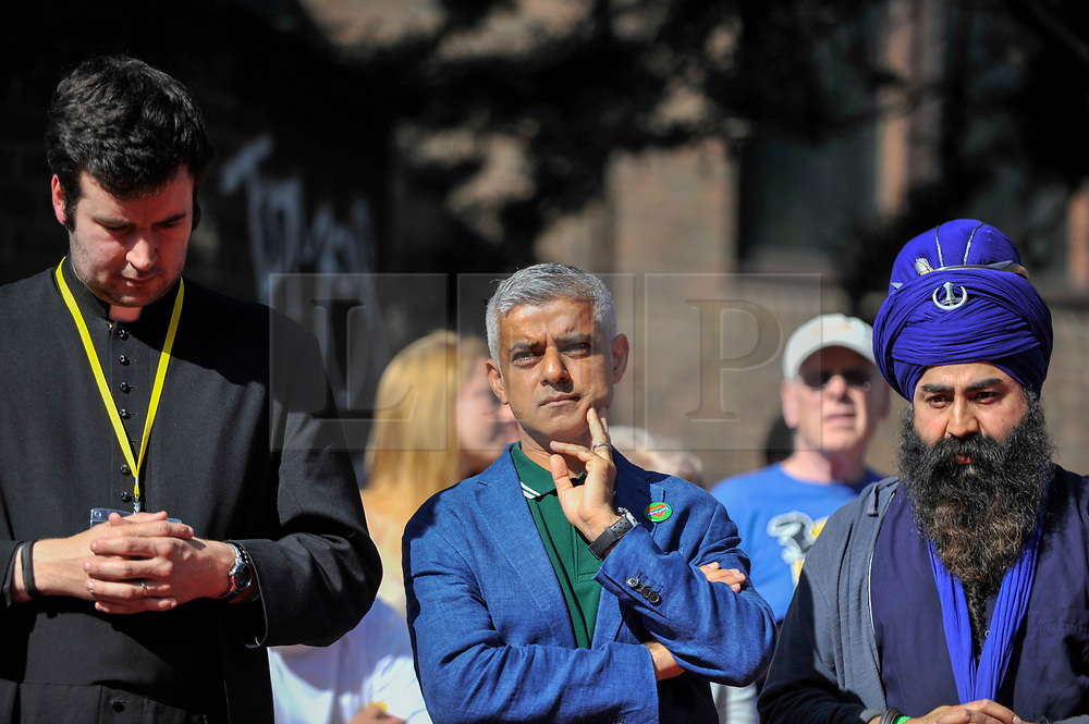 © Licensed to London News Pictures. 27/08/2017. London, UK. Sadiq Khan, Mayor of London, takes part in a multi-faith service ahead at the beginning of Family Day at the Notting Hill Carnival.  Over one million revellers are expected to attend Europe's biggest street party which takes place over the Bank Holiday Weekend. Photo credit : Stephen Chung/LNP