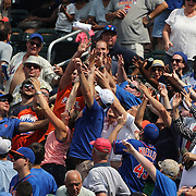 New York Mets fans tussel for a t-shirt toss during the New York Mets Vs Pittsburgh Pirates MLB regular season baseball game at Citi Field, Queens, New York. USA. 16th August 2015. Photo Tim Clayton