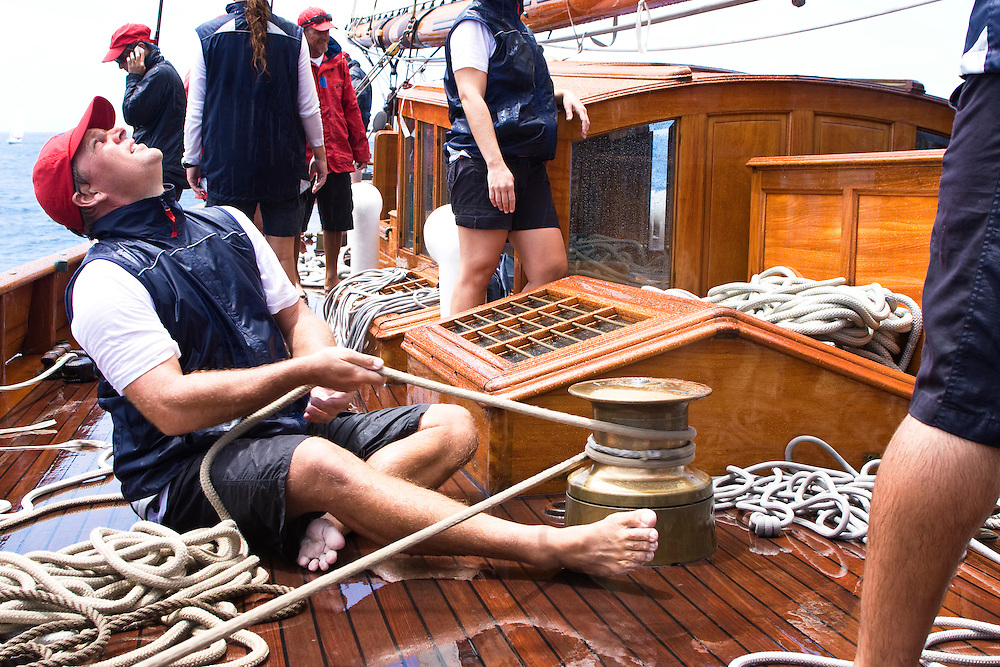 Crew member looks aloft as he controls a line from a winch on board the schooner yacht SY Altair during the 2008 Antigua Classic Yacht Regatta . This race is one of the worlds most prestigious traditional yacht races. It takes place annually off the cost of Antigua in the British West Indies. Antigua is a yachting haven, historically a British navy base in the times of Nelson.