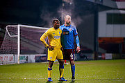 AFC Wimbledon forward Dominic Poleon (10) marked by Scunthorpe United defender David Mirfin (6)  during the EFL Sky Bet League 1 match between Scunthorpe United and AFC Wimbledon at Glanford Park, Scunthorpe, England on 28 February 2017. Photo by Simon Davies.
