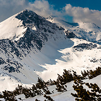 Mountain peak covered with snow at winter time