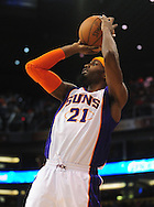 Feb. 17, 2011; Phoenix, AZ, USA; Phoenix Suns forward Hakim Warrick (21) puts up a shot against the Dallas Mavericks at the US Airways Center. The Mavericks defeated the Suns 112-106. Mandatory Credit: Jennifer Stewart-US PRESSWIRE