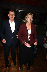 SIMON & ANNABEL ELLIOT she is the sister of Camilla Parker Bowles at a party to celebrate the publication of 'E is for Eating' by Tom Parker Bowles held at Kensington Place, 201 Kensington Church Street, London W8 on 3rd November 2004.<br />