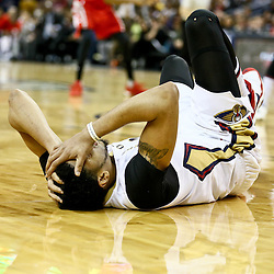 Jan 25, 2016; New Orleans, LA, USA; New Orleans Pelicans forward Anthony Davis (23) lays on the floor after taking an elbow to the head during the second quarter of a game against the Houston Rockets at the Smoothie King Center. Mandatory Credit: Derick E. Hingle-USA TODAY Sports