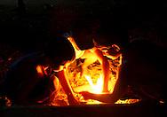 Children lighting a fire at a farm in Playa La Altura, Pinar del Rio, Cuba.