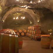 The cellar cave at The Gibbston Valley vineyard in Gibbston Valley, Central Otago. The winery includes a cave which has been blasted out of the solid schist of the Central Otago mountains, and creates an ideal natural environment to mature award-winning wines, Gibbston Valley Wines,  Queenstown, Central Otago, New Zealand. 23rd March  2011. Photo Tim Clayton.
