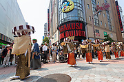Traditional festival musicians take part in the Daigyoretsu or Grand on  first day of the three-day Sanja Matsuri, Asakusa, Tokyo, Japan. Friday May 18th 2018. The Sanja matsuri, or festival, takes place over the third weekend of May in the streets around the famous Senso-ji Temple. It lis one of the biggest festivals in Japan and lasts for three days  (May 18th to May 20th) with parades of large mikoshi, or portable shrines, carried around the streets by crowds of supporters