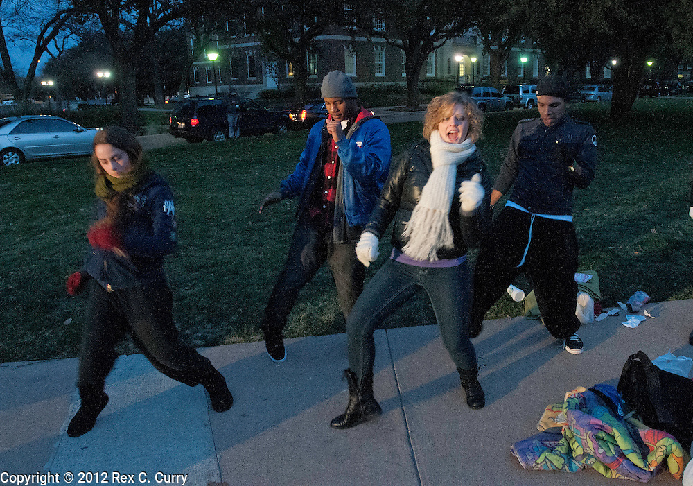 "Sarah Guarino, left, from Cypress, Tx. Aaron Blaylock, from Dallas, Codi Starner from Phoenix  and Matt Rodriguez, from Lawrence, Ks. work on their dance moves after meeting while waiting in the early morning cold to audition for ""So You Think You Can Dance"" at SMU on Friday, Jan. 13, 2012."