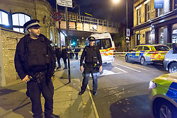 © Licensed to London News Pictures. 16/10/2017. LONDON, UK.  Police vehicles outside Parsons Green tube station, where three men have been stabbed.  Photo credit: Vickie Flores/LNP
