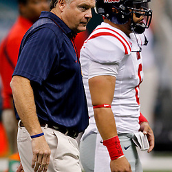 Sep 11, 2010; New Orleans, LA, USA; Mississippi Rebels head coach Houston Nutt on the field during warm ups before a game against the Tulane Green Wave at the Louisiana Superdome. The Mississippi Rebels defeated the Tulane Green Wave 27-13.  Mandatory Credit: Derick E. Hingle