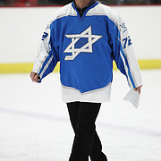 Consul General of Israel to New England Yehuda Yaakov walks on the ice prior to the game at Johnson Ice Rink on March 1, 2014 in Cambridge, Massachusetts . (Photo by Elan Kawesch/CJP)
