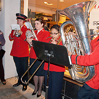 Jean McNeil Wyner rings the bell for the Salvation Army while the Salvation Army band  performs  Christmas classics during the annual Montana Avenue Holiday Walk on Friday, December 3, 2010.