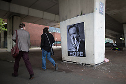 "© Licensed to London News Pictures . 23/05/2015 . Manchester , UK . A poster featuring an image of David Cameron burning cash , with the caption "" HOPE "" , pasted in an underpass in central Manchester . Photo credit : Joel Goodman/LNP"