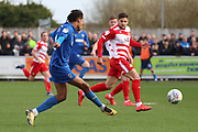 AFC Wimbledon defender Toby Sibbick (20) with shot on goal during the EFL Sky Bet League 1 match between AFC Wimbledon and Doncaster Rovers at the Cherry Red Records Stadium, Kingston, England on 9 March 2019.