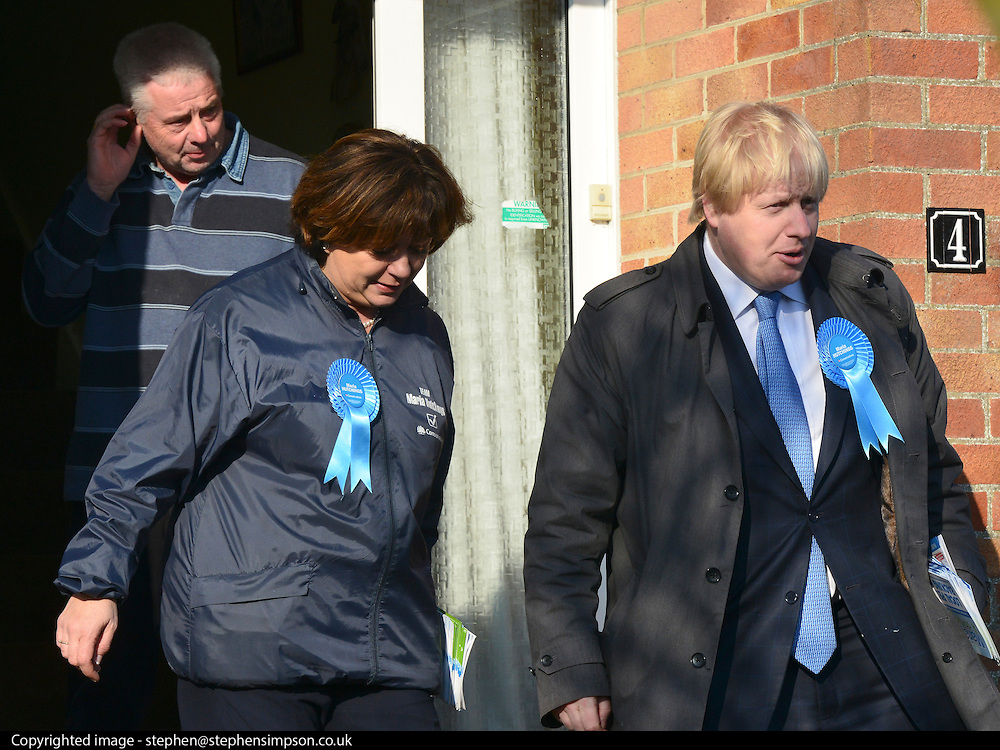 © Licensed to London News Pictures. 20/02/2013. Eastleigh, UK Boris Johnson and Maria Hutchins leave a property after speaking to the house owner. . London Mayor and member of the Conservative Party, Boris Johnson, and Conservative Candidate Maria Hutchins campaigning in the Eastleigh By-Election today 20th February in Stamford way, Eastleigh. Photo credit : Stephen Simpson/LNP