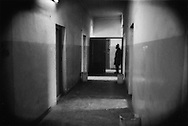 Man, whose family member is a psychiatric patient stands in hallway of Kabul's only gov't run mental hospital, Kabul, Afghanistan.  Family members often come from hundreds of kilometers away to be with patients while at the hospital.