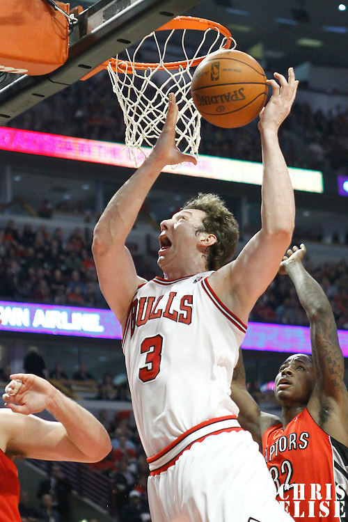 24 March 2012: Chicago Bulls center Omer Asik (3) is fouled on his way to the basket during the Chicago Bulls 102-101 victory in overtime over the Toronto Raptors at the United Center, Chicago, Illinois, USA.