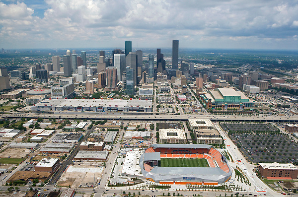 Aerial view of skyline of Houston, Texas from EaDo with BBVA Compass Stadium, George R Brown Convention Center, Minute Maid Stadium, Toyota Center in foreground.