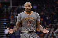 Feb 4, 2016; Phoenix, AZ, USA;  Phoenix Suns forward P.J. Tucker (17) reacts to a call during the game against the Houston Rockets at Talking Stick Resort Arena. The Rockets won 111 - 105. Mandatory Credit: Jennifer Stewart-USA TODAY Sports