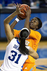 UK forward/center Samantha Drake, front, contests a shot by Tennessee forward Jasmine Jones in the first half. The University of Kentucky Women's Basketball team hosted Tennessee , Sunday, March 03, 2013 at Memorial Coliseum in Lexington . Photo by Jonathan Palmer