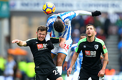 Steve Mounie of Huddersfield Town beats Ryan Fraser of Bournemouth to a header - Mandatory by-line: Robbie Stephenson/JMP - 11/02/2018 - FOOTBALL - The John Smith's Stadium - Huddersfield, England - Huddersfield Town v Bournemouth - Premier League