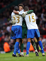 David James Celebrates dramatic Victory with team mates Sol Campbell and Sylvain Distin<br /> Portsmouth 2007/08<br /> Manchester United V Portsmouth (0-1) 08/03/08<br /> The FA Cup 6th Round<br /> Photo Robin Parker Fotosports International