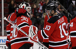Oct 17, 2009; Newark, NJ, USA; The New Jersey Devils congratulate New Jersey Devils goalie Martin Brodeur (30) after the third period at the Prudential Center. The Devils defeated the Hurricanes 2-0.  The shutout was Brodeur's 102nd of his career, leaving him one away from tying the NHL record.