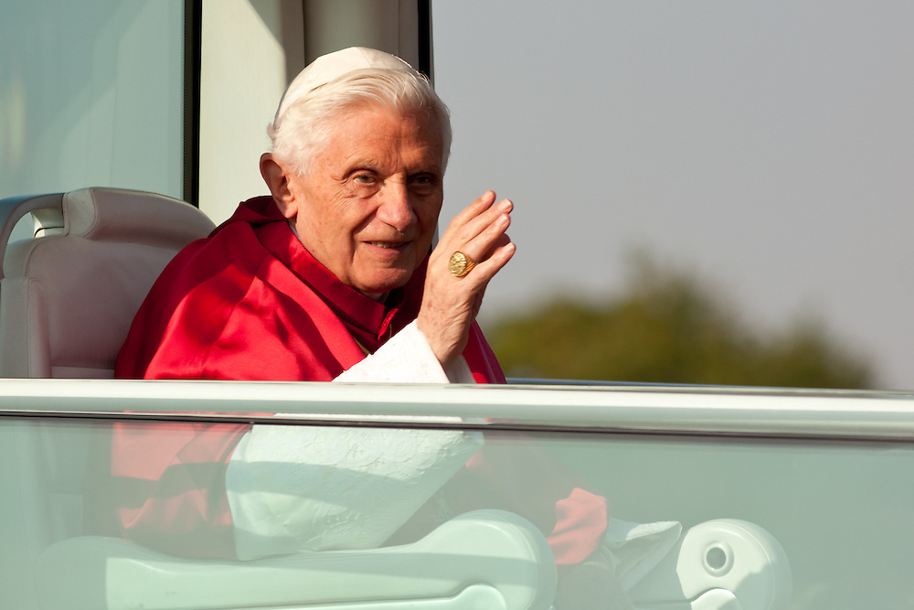 Freiburg, Germany. September 25, 2011. Pope Benedikt XVI waves from his Popemobile during his visit in Freiburg on  Sunday. Photo: Miroslav Dakov
