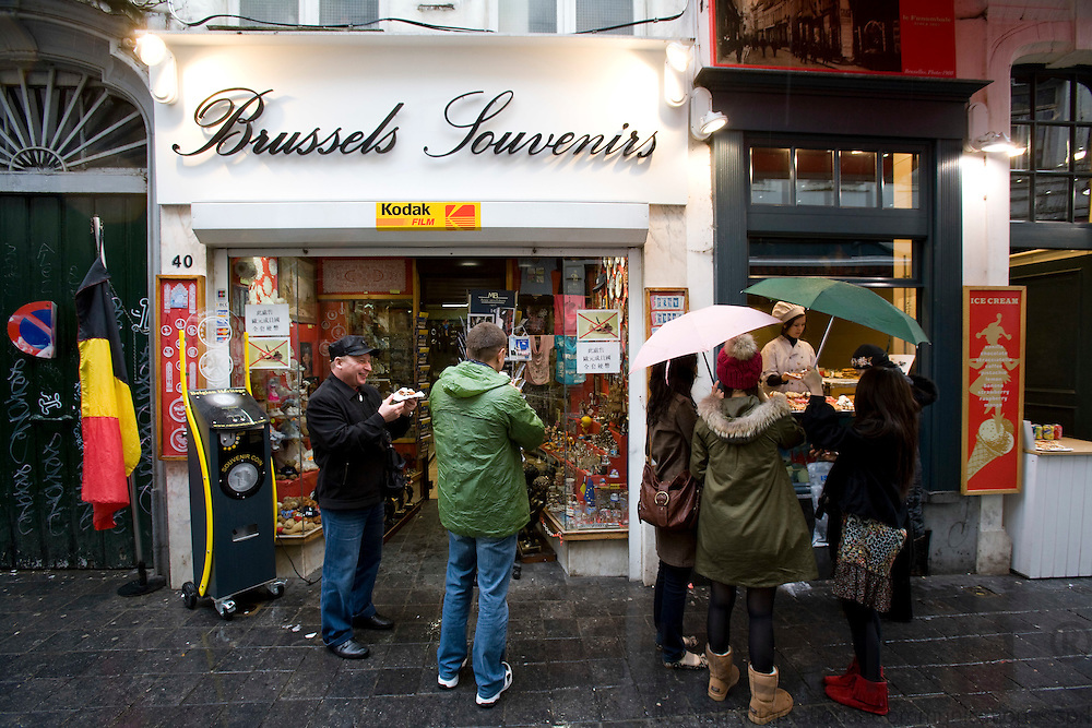 BRUSSELS - BELGIUM - 21 OCTOBER 2008 -- Tourists standing outside a souvenir shop in Brussels on a raining day. Photo: Erik Luntang